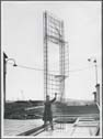 Click to select: Construction Photographs - Worker with Panel Frame