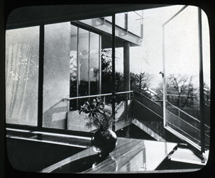 Click to select: View of Lower Terrace from Living Room Window with Flower Arrangement in Foreground